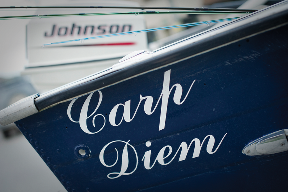 Close up photo of a boat named Carp Diem