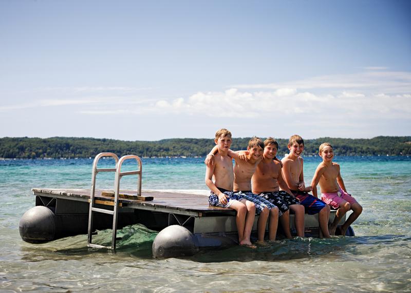 kids on lake dock