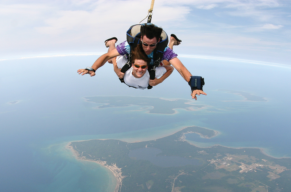 Luther Kurtz instructs his cousin, Julie Church, during her first tandem skydive over Beaver Island.