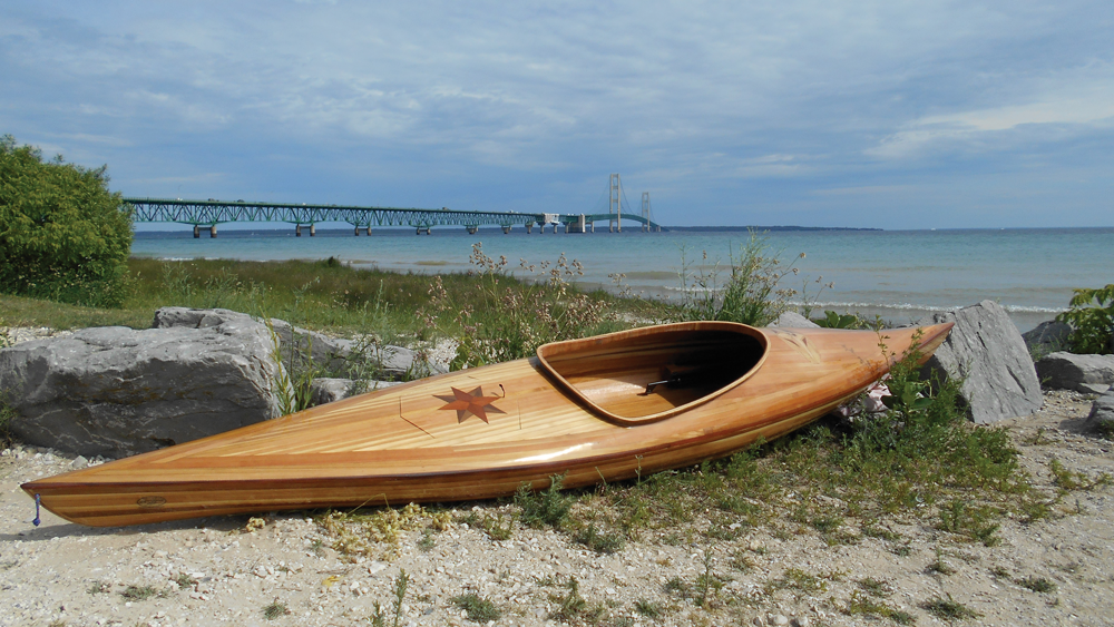 canoe with star ingrained in wood