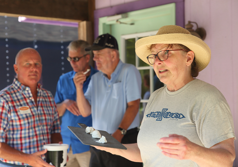 Cathy Halinski owner of Evergreen Lane Farm and Creamery talks to participants about her cheeses.