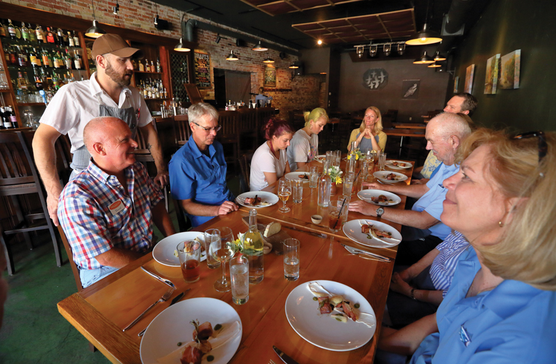 Salt of the Earth Chef Matthew Pietsch educates the Westmaas family on the plates he has prepared for them