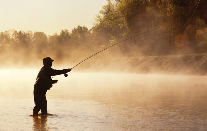 Silhouette of Fly Fisherman