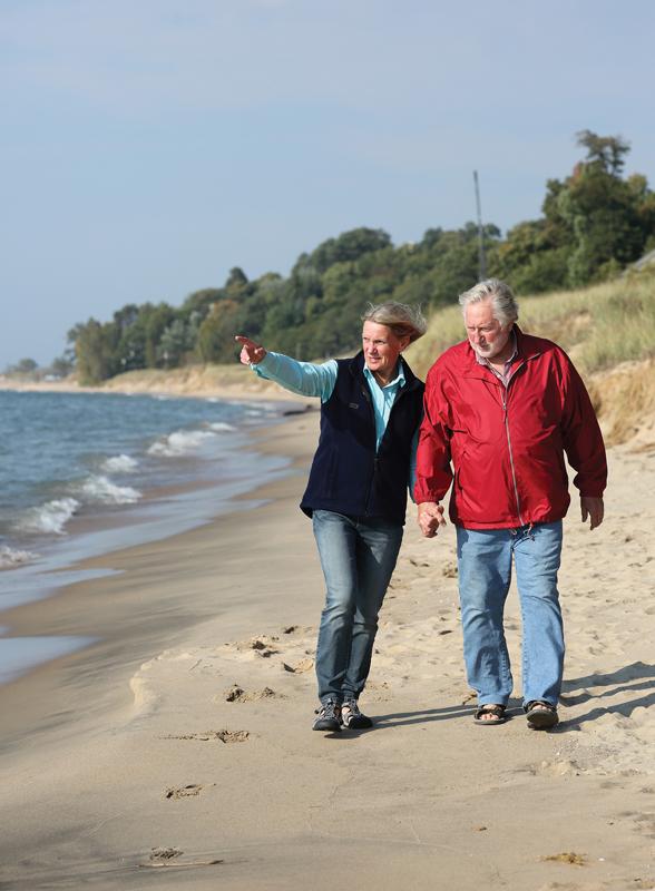 Mary MckSchmidt walks along the beach