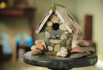 Beach stone birdhouse