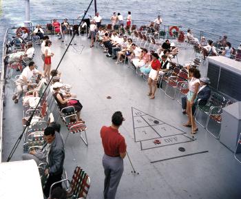 Shuffleboard game on deck