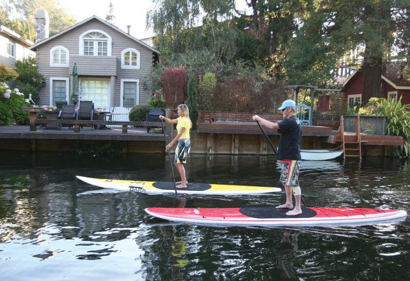 SUP enthusiasts paddling