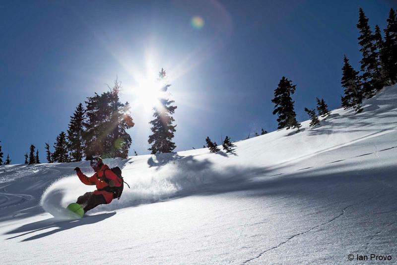 Ian Provo snowboarding down mountain