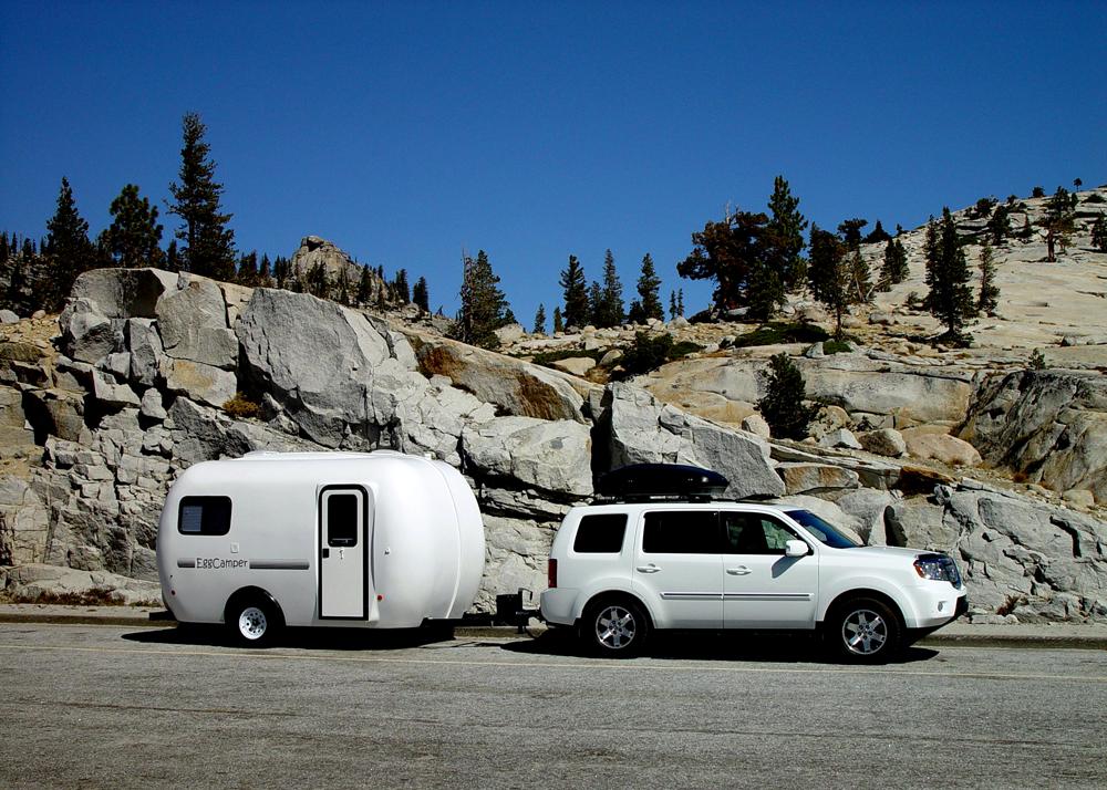 white RV in the mountains