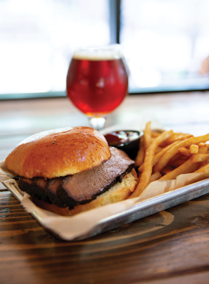 Smoked meat, fries, and a good beer make a perfect meal.