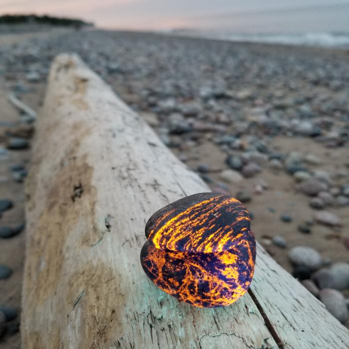 Upper Peninsula rockhound Erik Rintamaki discovered rocks that glow under ultraviolet light on a Lake Superior shoreline at night while searching for agates.