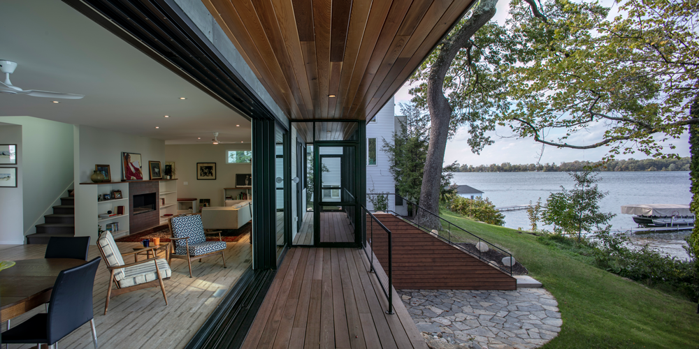 A wraparound deck spans three sides of the distinctive dwelling with a wider section on the side reserved for al fresco meals that lure the locals.