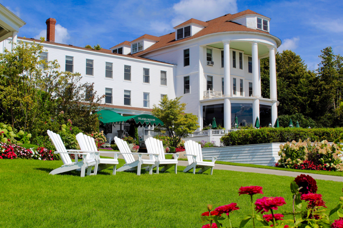 Sunning on the lawn amid the gardens at the island House Hotel is to revel in its history.