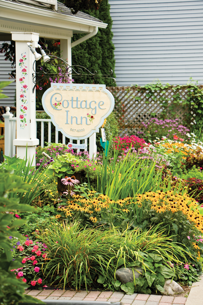 Small gardens add a splash of color to businesses like the Cottage Inn.