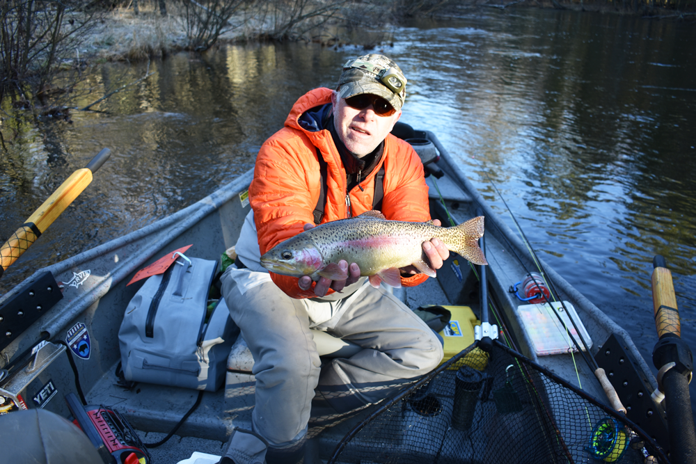 Guide Ryan White holds up a PM River rainbow trout (steelhead).