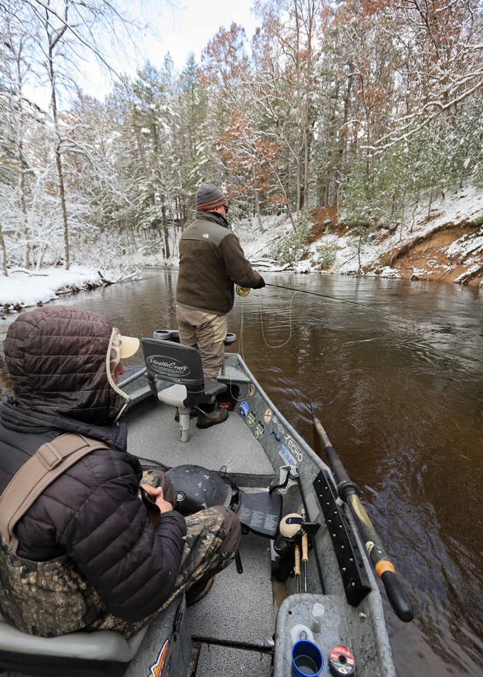 Fishing guide Kyle Hartman, left, tries his luck as Hensley watches.